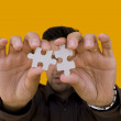 Puzzle Man (focus on the puzzle) — Stock Photo