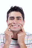 Young man with a funny face — Stock Photo