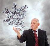 Businessman holding money — Stock Photo