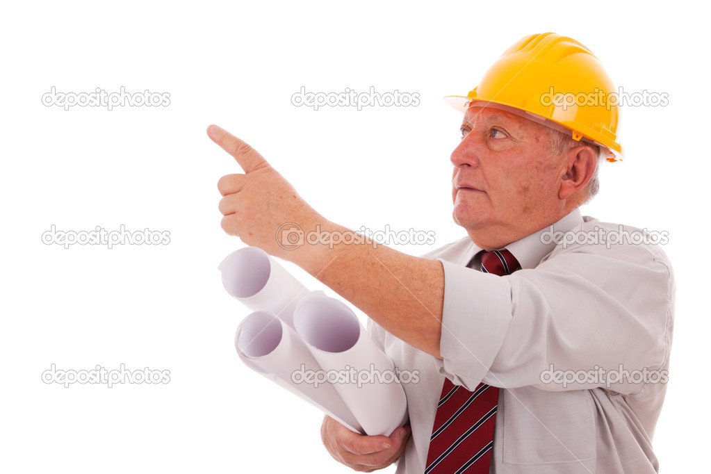 Experienced engineer holding some blueprints and pointing to the copyspace (isolated on white) — Stock Photo #8465510