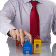 Stock Photo: Businessman selling a house
