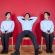 Three twin businessman waiting — Stock Photo