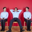 Three twin businessman waiting - Stock Photo