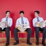 Three businessman reading a newspaper — Stock Photo #8573691