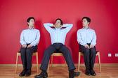 Empresario tres twin esperando — Foto de Stock