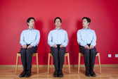 Three twin businessman waiting — Stock Photo
