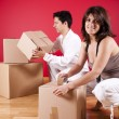 Young couple packing — Stock Photo