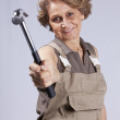 Senior woman with a hammer — Stock Photo #8583654