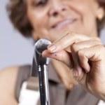 Senior woman driving a nail — Stock Photo #8583669