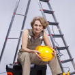 Senior woman sitting in a toolbox — Stock Photo #8583685