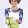 Senior woman with a sprout — Stock Photo