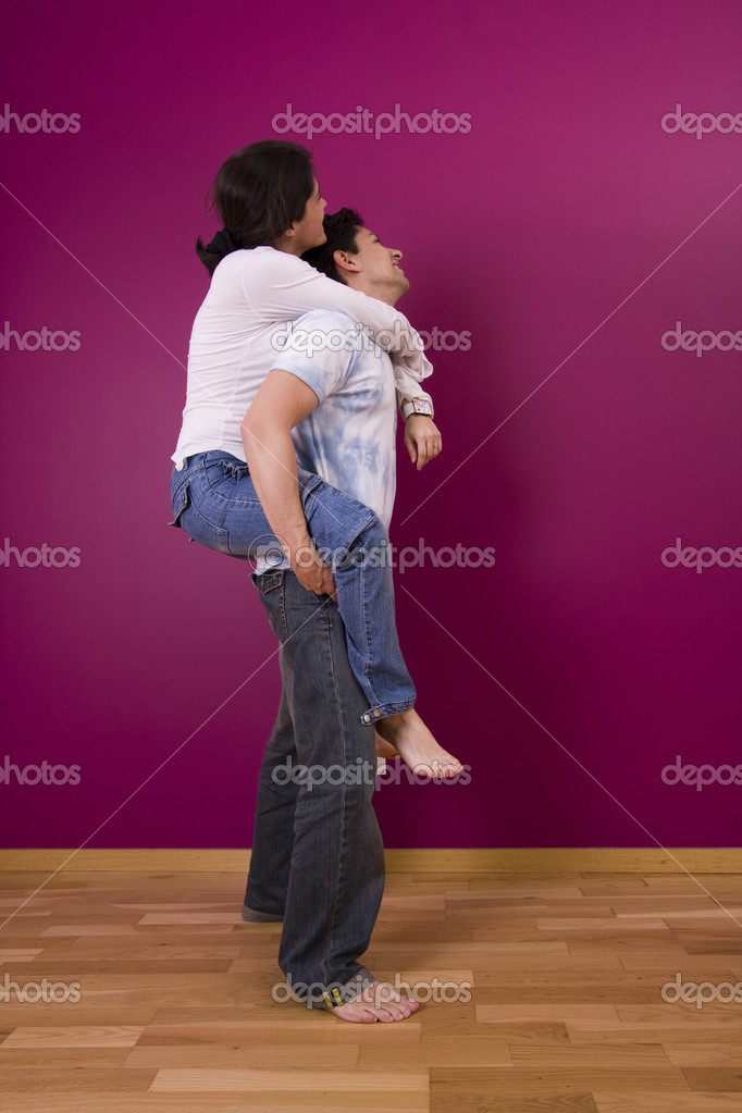 Couple enjoying the new painted wall — Stock Photo #8581318