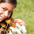 Child enjoying her fresh flowers — Stock Photo