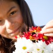 Little child with fresh flowers — Foto Stock