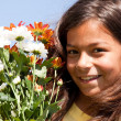 Little child with fresh flowers — Stock Photo