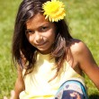 Child with a flower — Stockfoto