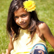 Stock Photo: Child with a flower