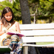 Stock Photo: Reading at the park