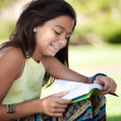 Stock Photo: Children reading a book