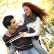 Young couple having fun at the park — Stock Photo