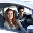 Young couple inside car — Stock Photo #8630341