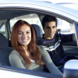 Young couple inside the car — Stock Photo