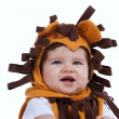 Baby with a lion mask — Stockfoto