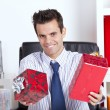 Happy businessman giving christmas gifts — Stock Photo