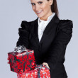 Businesswomwith many gift packages — Stock Photo #8633384
