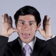 Young businessman with a funny face — Stock Photo