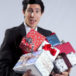Businessman with many gift packages — Stock Photo