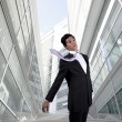 Businessman with a flying necktie — Stock Photo