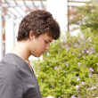 Teenager sending SMS - Stock Photo