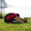 Stock Photo: Athlete warming and stretching
