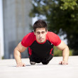 Athlete man making pushups — Stock Photo