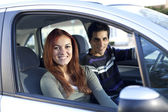 Young couple inside the car — Stock fotografie
