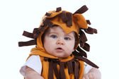 Baby with a lion mask — Stock Photo