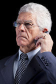 Senior Businessman talking at the cellphone — Stock Photo