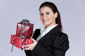 Businesswoman with many gift packages — Stock Photo