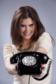 Sexy woman holding a telephone — Stock Photo