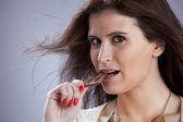 Woman biting chocolate — Stock Photo