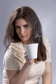 Woman drinking a hot drink — Stock Photo