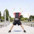 Athlete warming and stretching — Stock Photo #8640003