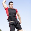 Athlete jumping at the park — Stock Photo #8640007