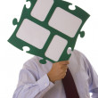 Businessman holding puzzle piece — Stock Photo