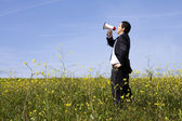 Businessman speaking with a megaphone — Stock Photo