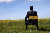 Businessman sitting in a chair — Stock Photo