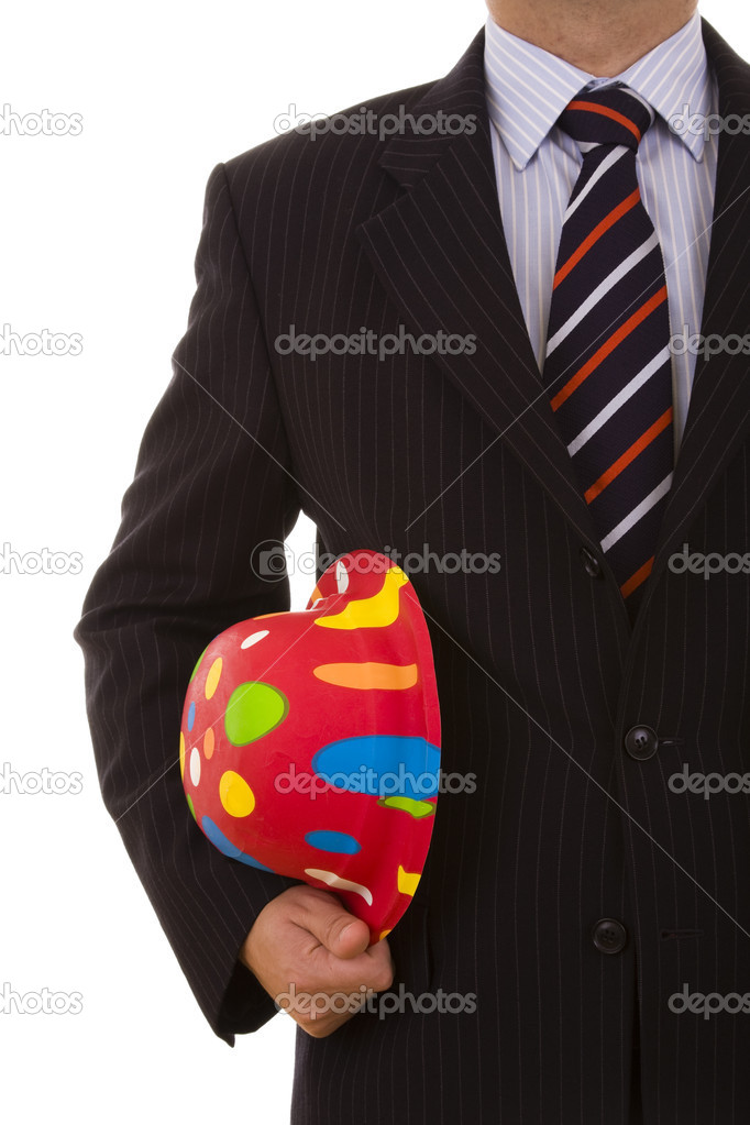 Businessman holding a new year hats (selective focus) — Stock Photo #8648809