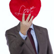 Businessman with love heart face — Stock Photo #8658024