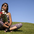 Teenager with fresh flowers — Stock Photo